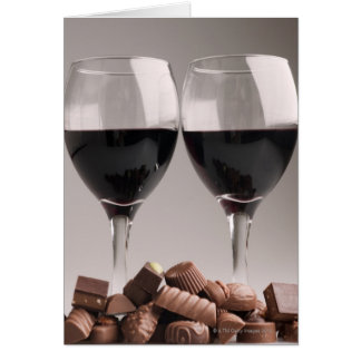 red wine with chocolates greeting card