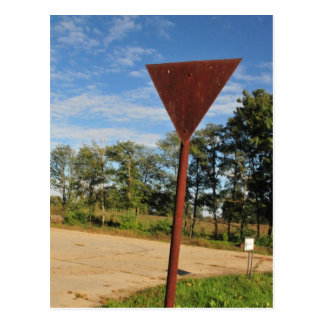 Rusty street sign and blue skies postcard