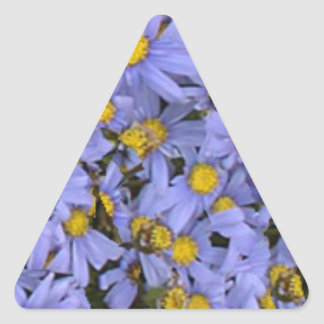 Scattered bunch of blue daisies, very pretty! triangle sticker