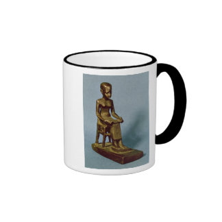 Seated statue of Imhotep  holding an open Ringer Mug