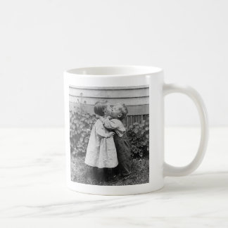 She gets the penny, He gets the kiss Basic White Mug