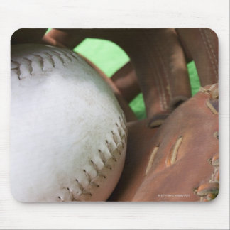 Softball in catcher's glove mouse pad