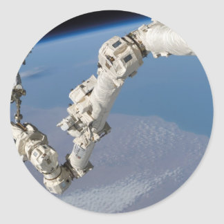 STS-114_Steve_Robinson_on_Canadarm2.jpg Round Sticker