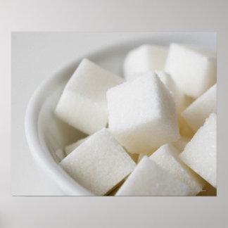Studio shot of sugar cubes in bowl poster