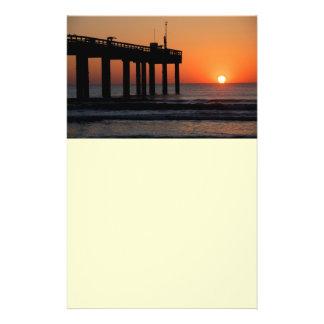 Sunrise over ocean fishing pier flyer