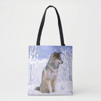 Timber Wolf sitting in the Snow, Canis lupus Tote Bag