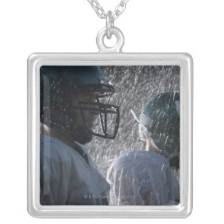 Two American football players in rain, side view Square Pendant Necklace