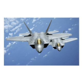 Two F-22 Raptors fly over the Pacific Ocean Photograph