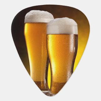 Two glasses of beers on a wooden table plectrum