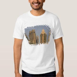 UAE, Dubai. Minaret of mosque in Al Wasl, with T-shirts