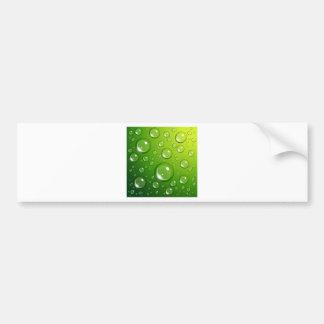 Water drops on green bumper sticker