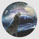 Wolf howling at the moon round sticker