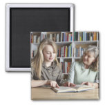 Woman and granddaughter reading together square magnet