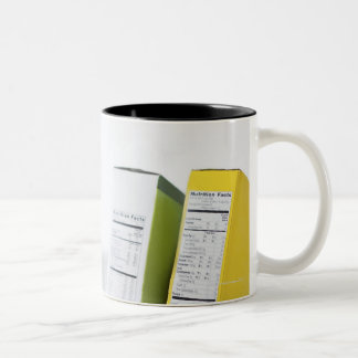 Woman comparing nutrition labels Two-Tone mug