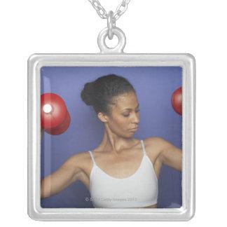 Woman lifting dumbbells 3 square pendant necklace