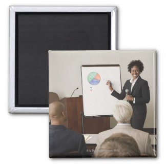 Woman teaching a class to adults square magnet