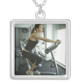 Woman working out in a gym 3 square pendant necklace