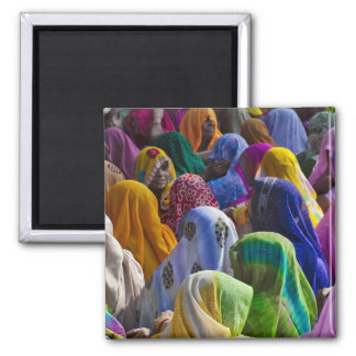 Women in colorful saris gather together square magnet