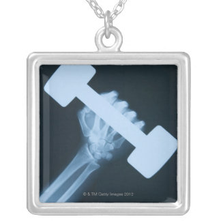 X-ray image of human hand with weight, close-up square pendant necklace